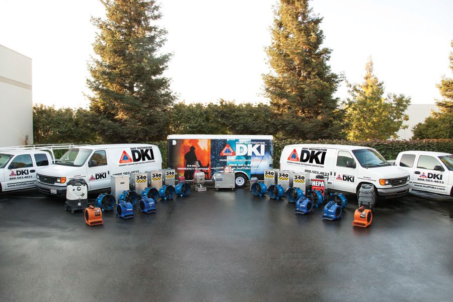 Image of Huff Construction's DKI Restoration Services Fleet. They offer building restoration services to buildings that have fire damage, water damage, etc.