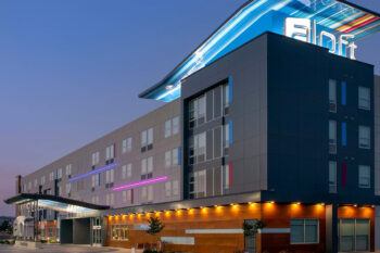 Exterior photo shot at dusk of the Aloft Hotel in Dublin California built by Huff Construction Company, Inc.