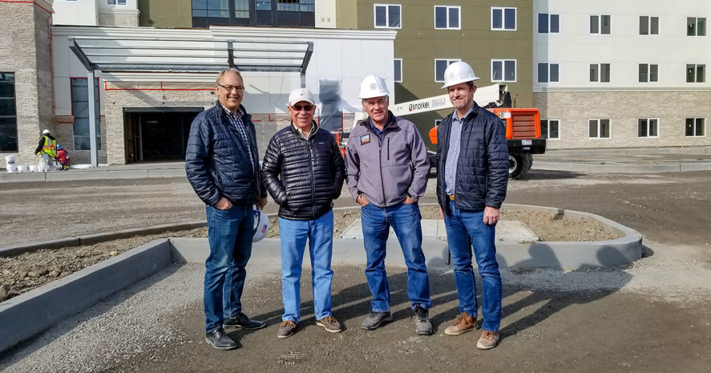 From left to right: Gary Huff (CEO), Duane Huff (Founder), Dave Royalty (Retired Superintendent), Larry Nelson (Project Manager)