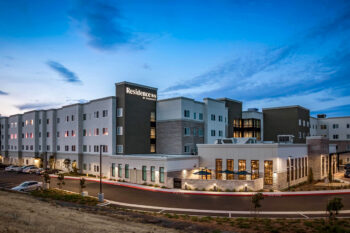 Exterior photo of the Residence Inn and Fairfield Inn Dual Branded Hotel in San Jose, CA during Twilight